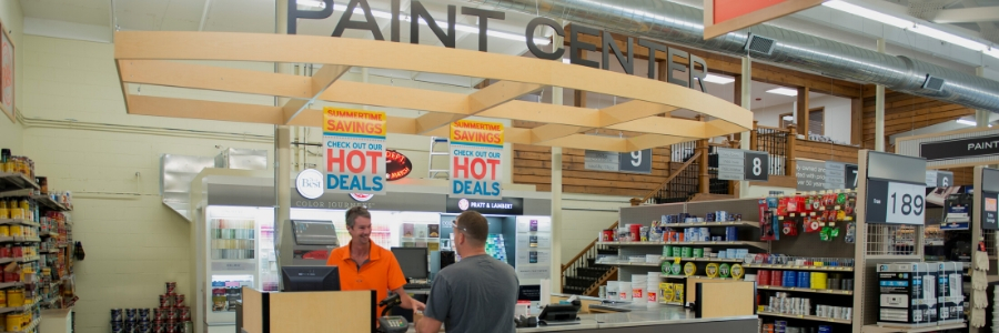 two men standing at paint counter